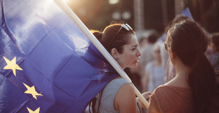 "Athens, Greece - July 3, 2015: A woman waving an EU flag during a protest in Panathinaikon Stadium (Kalimarmaro) in Athens, in favour of ""NAI"" or YES in the Greek Referendum voting."
